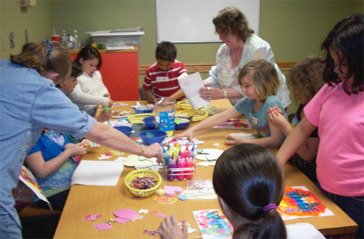 Photo of families working on a creative project at Maryland Public Library